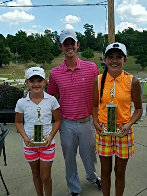 Kira Moore of Ashland (right) won the girls 13-14 division and had the best overall score among girls with a 161 in the Richland County Junior Championship. With her and Jake Houston, the assistant pro at Westbrook Country Club, is runner-up Brooklyn Adkins.
