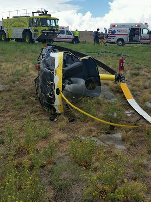 A helicopter sits in wreckage after a crash Tuesday at the Prescott Municipal Airport.