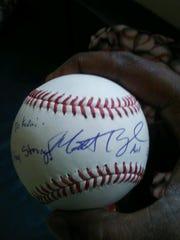 A baseball for Karai Moore signed by Tigers pitcher Matt Boyd.