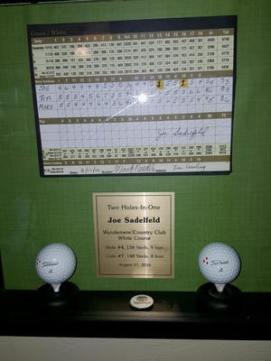 A plaque with the scorecard of Naples' Joe Sadelfeld shows his two holes-in-one on Aug., 17, 2016, at Wyndemere Country Club.