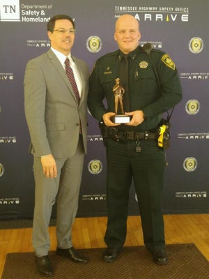 Madison County Sheriff's Office Deputy Bill Holbrook (right, with Vic Donaho, director of the Tennessee Highway Safety Office), was named Deputy of the Year.