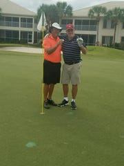 Gregg Shires (left) and Greg McCall pose after making back-to-back holes-in-one on No. 8 at Estero Country Club at The Vines on Sunday, Jan. 15, 2017.