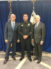 Jackson Police Department Capt. Phillip Kemper, center,