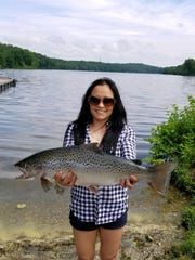 Runlevy Rodriquez with her record New Jersey landlocked salmon caught at Lake Aeroflex in 2018.