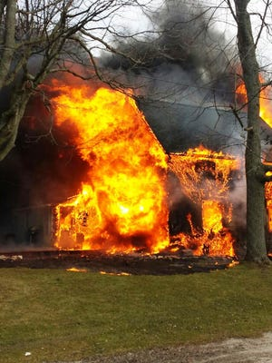 Fire erupts from a house at 23 Fourth St. in Yale
