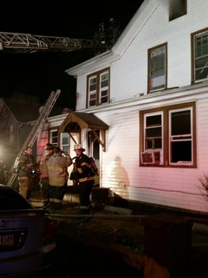 Firefighters battle a blaze at 35 Johnson St. in Spring Valley that left eight families homeless.