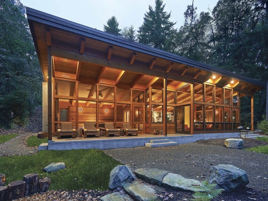 "This Vashon Island, Wash., house, built with structural insulated panels and a timber frame, was designed by FabCab and is 1,750 square feet. It's featured in ""Prefabulous Small Houses."""