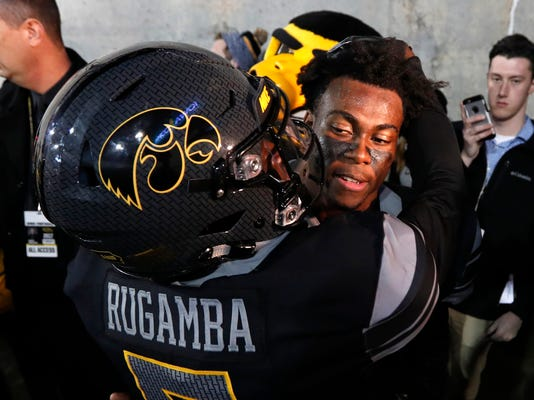 Iowa defensive back Joshua Jackson celebrates with teammate Manny Rugamba, left, after an NCAA college football game against Ohio State, Saturday, Nov. 4, 2017, in Iowa City, Iowa. (AP Photo/Charlie Neibergall)