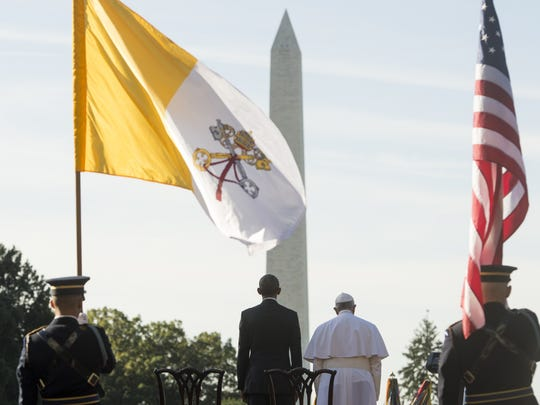 President Obama stands alongside Pope Francis during an arrival ceremony on the South Lawn of the White House on Sept. 23, 2015.