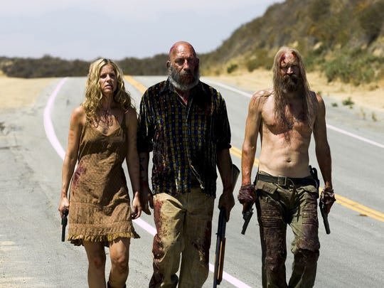 """In this photo provided by Lions Gate Films, Sheri Moon Zombie (from left) as Baby, Sid Haig as Captain Spaulding and Bill Moseley as Otis Driftwood appear in """"The Devils Rejects."""""""