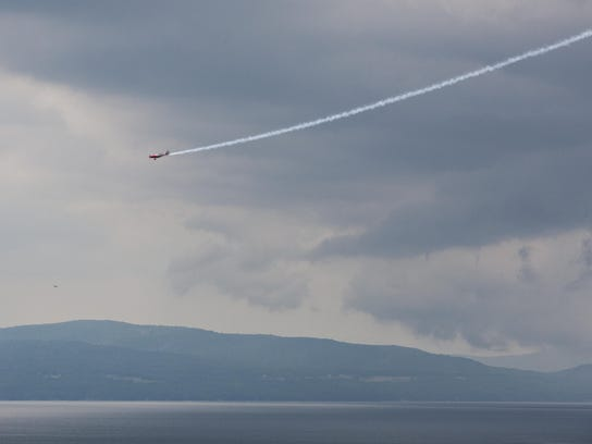 A plane flies over Lake Champlain in Burlington on