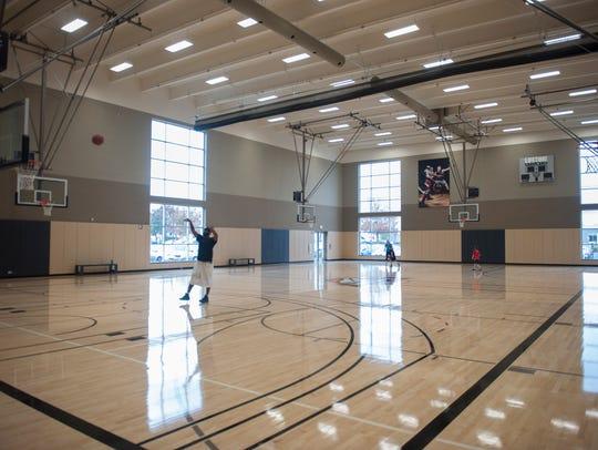 Club members shoot hoops at Life Time Athletic in Mt.