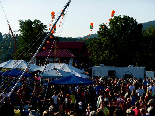 People mill about during the first Townsend Balloon Festival in August 2017. The event returns this Saturday.