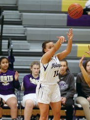 Olivia Selembo of North Kitsap shoots a 3-pointer against Port Angeles on Tuesday. Like players at all levels, high school basketball players are taking more 3-pointers now than ever before.