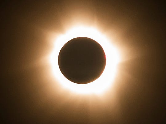 A total solar eclipse is seen at Cape Tribulation in