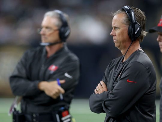 Dec 24, 2016; New Orleans, LA, USA; Tampa Bay Buccaneers offensive coordinator Todd Monken, right, in the first quarter against the New Orleans Saints at the Mercedes-Benz Superdome. Mandatory Credit: Chuck Cook-USA TODAY Sports