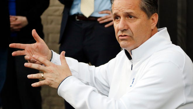 John Calipari, does a news conference on his patio after he and Kentucky's men's basketball team watched the NCAA college basketball tournament selection show in Lexington, Ky. March 15, 2015