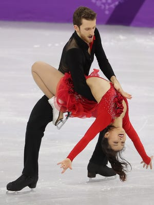 Feb 11, 2018; Pyeongchang, South Korea; Alexander Gamelin and Yura Min (KOR) compete in the Figure Skating-Team-Ice Dance Short Dance event during the Pyeongchang 2018 Olympic Winter Games at Gangneung Ice Arena. Mandatory Credit: Dan Powers-USA TODAY Sports  ***Headlines*** Olympics: Figure Skating-Team-Ice Dance Short Dance Olympics: Figure Skating-Team-Womens Short Program