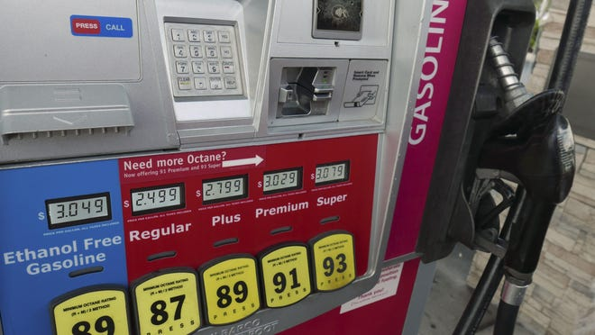 In this June 26, 2019 photo, various fuel prices are displayed on a pump at a gas station in Orlando, Fla.