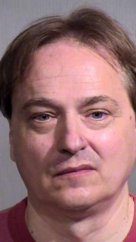 Peter Steinmetz was arrested July 28 for carrying a rifle at Phoenix Sky Harbor International Airport.