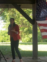 Theresa Greenfield, one of five Democratic candidates exploring bids for Iowa's Third Congressional seat, speaks at the Warren County Democrats picnic on June 25.