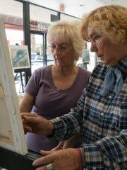 Instructor Valentina Lamdin works with student Barbara