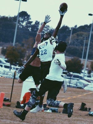 Incoming Northeastern freshman Kaden Hamilton (22) goes up for a catch at Football University's Top Gun camp last week in South Carolina. Hamilton competed against 500 of the nation's top Class of 2021 football players at the elite camp, along with incoming Northeastern freshman running back Manny Capo.