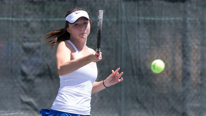 Xavier's Madison Clarke returns a ball to Chaparral's Rebecca Salaway during the Division 1 girls team tennis state match at Paseo Racquet Center in Glendale.