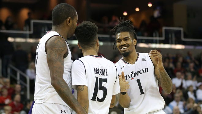 University of Cincinnati players Gary Clark, Cane Broome and Jacob Evans III (left to right) will help lead No. 1-seeded UC into the AAC tournament in Orlando.