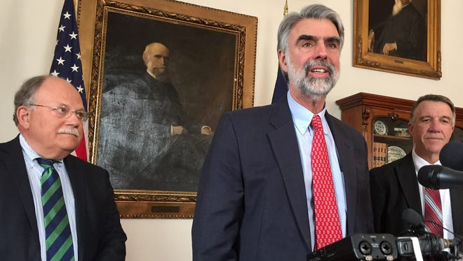 Jeb Spaulding, chancellor of the Vermont State Colleges, speaks to reporters at the Statehouse in Montpelier on March 27, 2018.