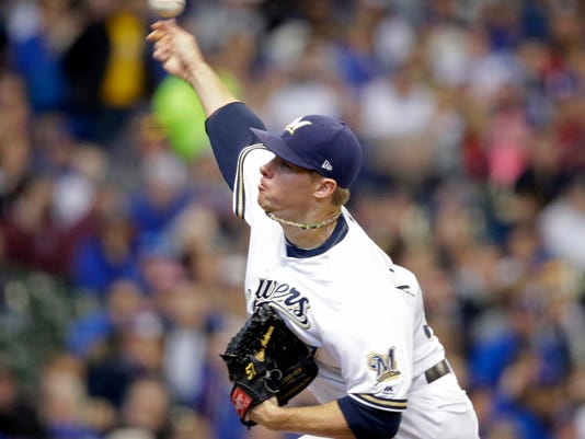Milwaukee Brewers starting pitcher Chase Anderson throws to the Chicago Cubs during the first inning of a baseball game Sunday, April 8, 2018, in Milwaukee. (AP Photo/Jeffrey Phelps)