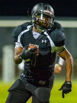 Sussex Tech fullback Timuan Williams (1) runs for a gain against Laurel on Friday evening at Sussex Tech.