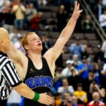 Kennard-Dale's Chance Marsteller greets the crowd's standing ovation after winning his fourth PIAA championship in March 2014.