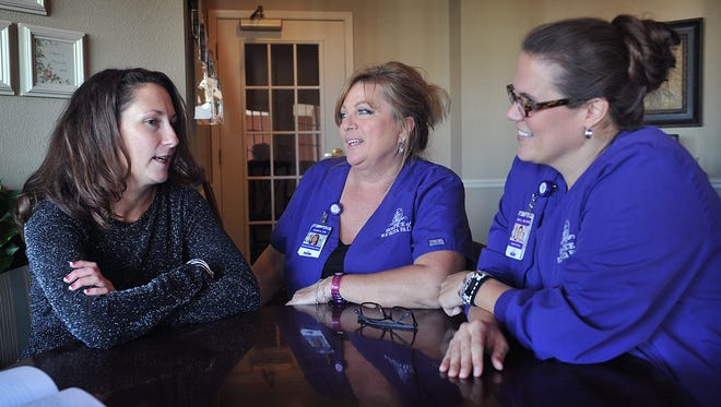 In this file photo, Carri Martini Murphree, left, talks with Hospice of Wichita Falls nurses Ellen Arnold, LVN and Amy Linn, RN, about the roles they played in helping her get through losing both of her parents, just eleven days apart. Hospice is offering volunteer training starting in October.