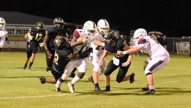 Cameron Edwards (1) hauls in a short pass and makes a big run for some tough yards early in the second quarter Friday night at the Mustangs build momentum.
