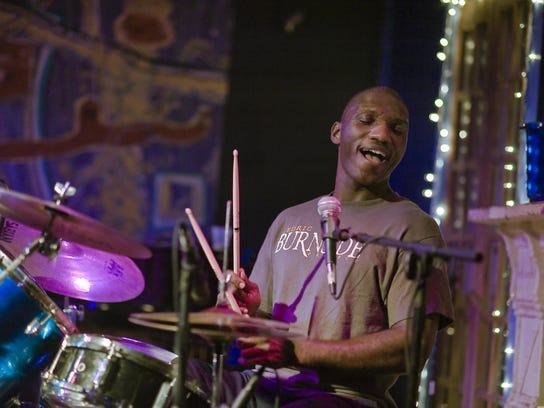 Cedric Burnside performing live in concert.