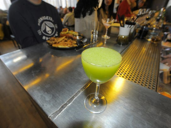 "The ""Snake in the Grass"" is a specialty cocktail offered"