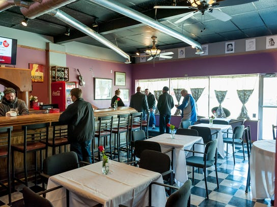 The eclectic cafe serves gourmet sandwiches and bar
