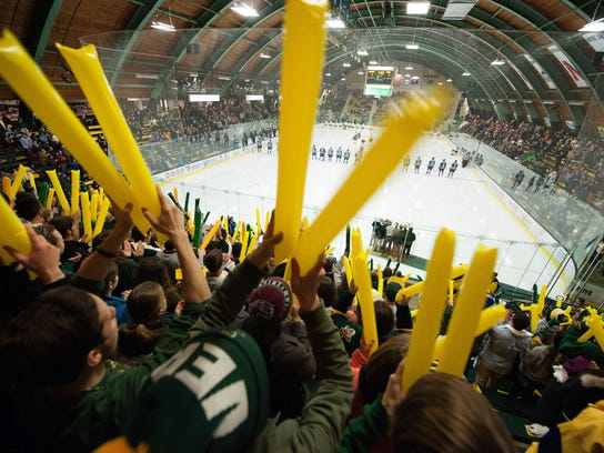 Fans cheer for Vermont during the hockey game between