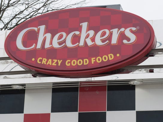 """The Checkers Drive-In motto for its fast food and mounted outside its stores is """"Crazy Good Food."""""""