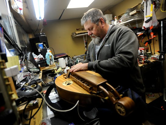 Robert Green, owner of BBB Music Center, pulls out
