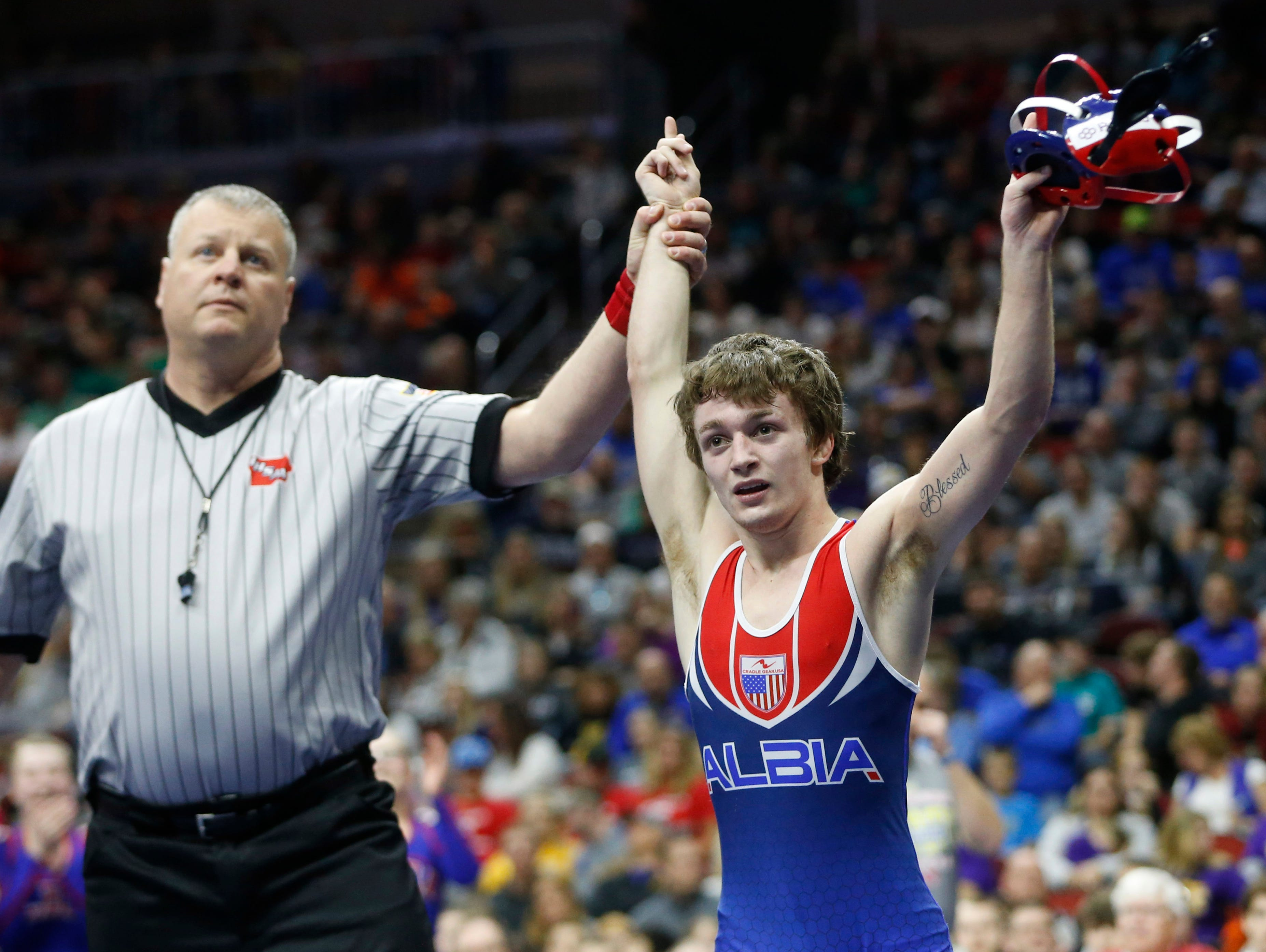 AlbiaÕs Aden Reeves wins the class 2A, 113-pound title match Saturday, Feb. 18, 2017 in the state wrestling finals at Wells Fargo Arena in Des Moines.