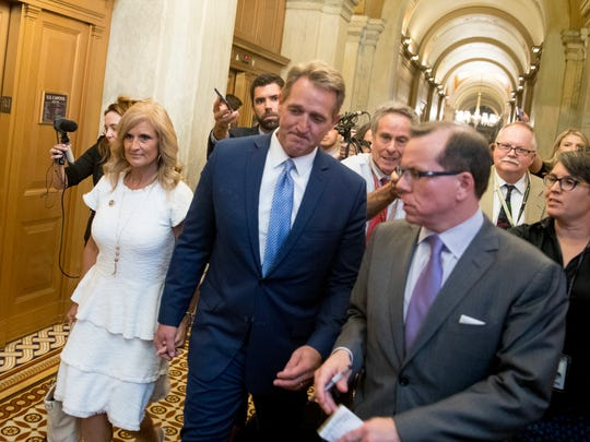 Sen. Jeff Flake, R-Ariz., accompanied by his wife Cheryl, leaves the Capitol in Washington on Oct. 24, 2017, after announcing he won't seek re-election in 2018.