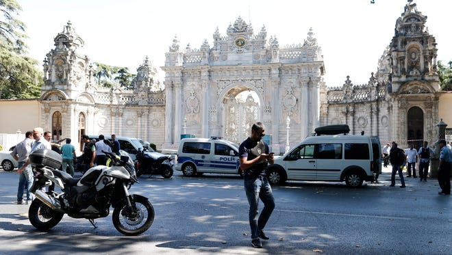 Turkish police secure the area following an attack outside the Dolmabahce Palace in Istanbul, Turkey, Aug. 19, 2015.