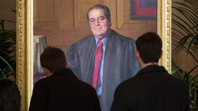 The law school at George Mason University in Virginia was dedicated Thursday in the name of the late Supreme Court justice Antonin Scalia, who died in February.