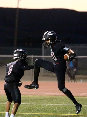 Shiprock's Adrian Gibson, right, and Quaid Shorty celebrate Gibson's touchdown against Gallup on Sept. 16 at Chieftain Stadium in Shiprock.