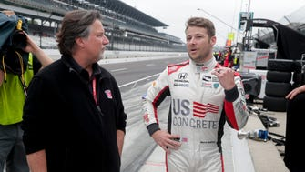 Marco Andretti, right, talks with his father and car owner Michael Andretti during a practice session for the IndyCar Indianapolis 500 auto race at Indianapolis Motor Speedway in Indianapolis Friday, May 18, 2018. (AP Photo/Michael Conroy) ORG XMIT: NAA125