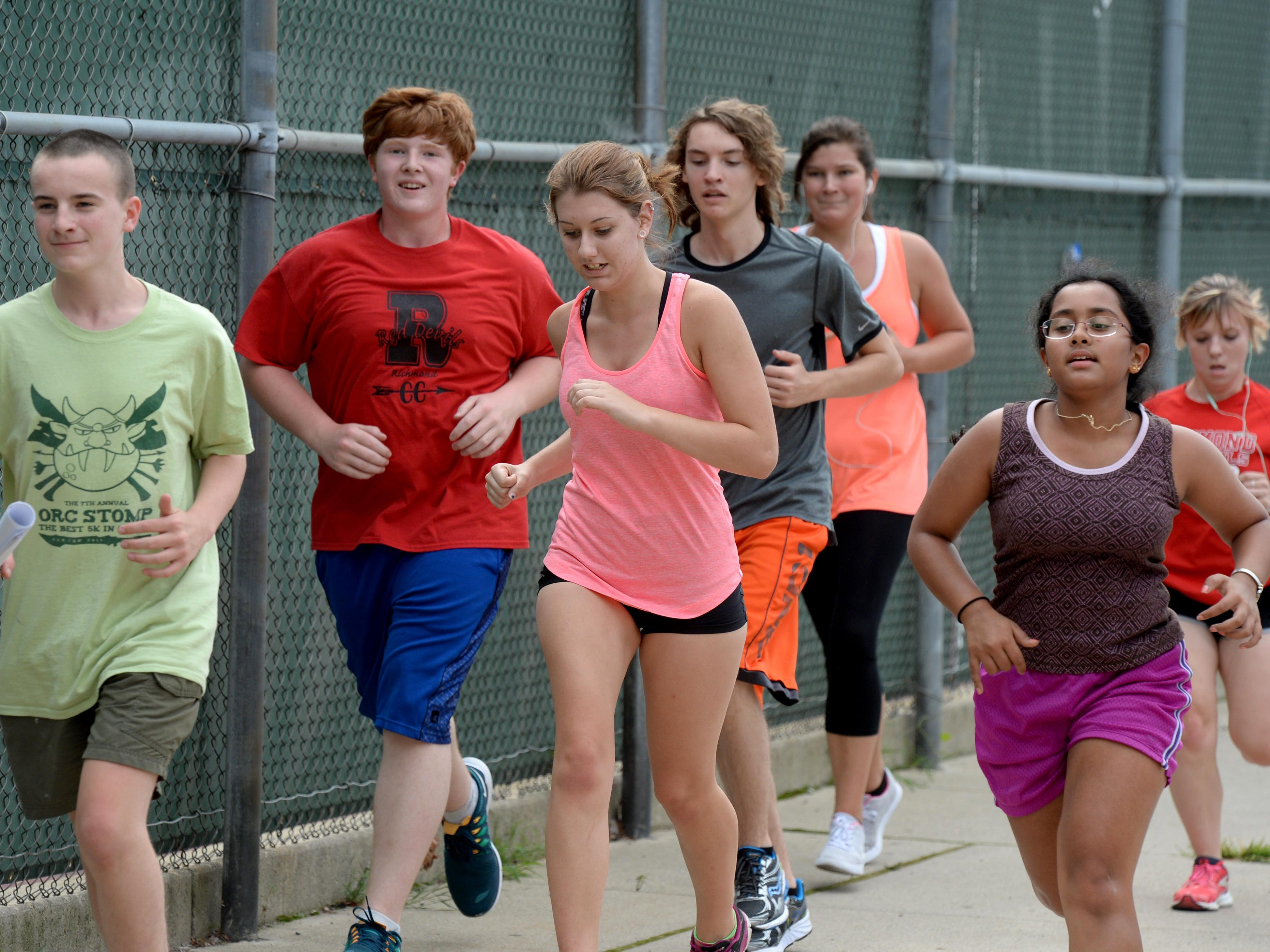 Richmond High School cross country runners practice Friday, Aug. 14, 2015, at Richmond.