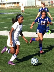 Lake View's Heaven Robinson moves the ball up field against Abilene Cooper in District 4-5A girls soccer action Tuesday, March 14, at Old Bobcat Stadium.