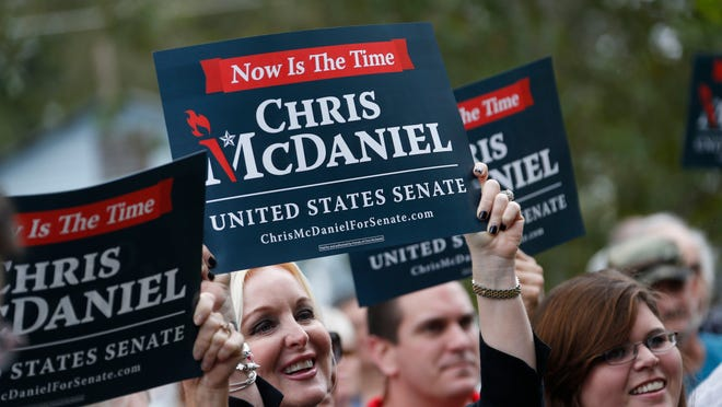Supporters of second-term state Sen. Chris McDaniel, R-Ellisville, hoist campaign signs as he announces his candidacy for the U.S. Senate in 2014, during a rally at the Jones County Courthouse in Ellisville, Miss., Thursday, Oct. 17, 2013. His decision to run will likely pit him against longtime incumbent Republican U.S. Sen. Thad Cochran in the Republican primary. (AP Photo/Rogelio V. Solis) ORG XMIT: MSRS105